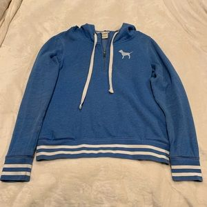 Blue hoodie with white stripes and pink dog logo